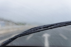 wipers on the windshield of the car in the rain